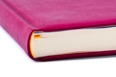 Book. The red closed book with a yellow bookmark. Isolated on white Stock Images