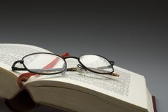 Book. Dark glasses on a book close up Royalty Free Stock Image