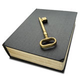 Book. A golden key on thick hard cover black book on white - with clipping path Stock Image