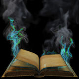 Book. Old empty open book in the magical flames. isolated on black Royalty Free Stock Photo