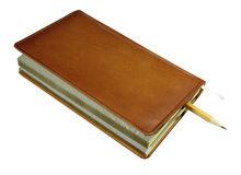 Book. Closed notebook with a pencil on a white background Stock Photography