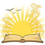 Book. Open magic book with sun in the background Royalty Free Stock Photo