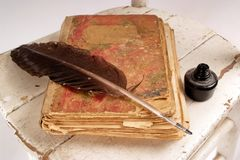 Book. Old book, quill and black ink on vintage chair Royalty Free Stock Images