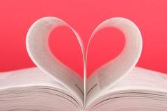 Book. The book, a symbol of heart Stock Photos