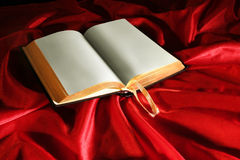 Book. On Red light effected background Stock Photography