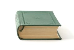 Book. With green cover on the background Royalty Free Stock Photography
