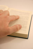 Book. With a hand Royalty Free Stock Photos