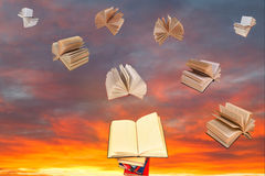 Book above of stack of books and sunset sky Royalty Free Stock Images