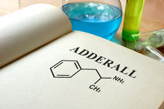 Book with adderall and test tubes. Book with adderall and test tubes on a table stock images