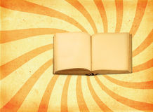 Book against retro background Stock Images