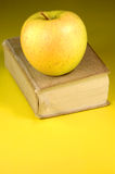 Book and apple. An apple on top of a book Stock Images
