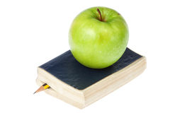 The book and an apple. Stock Photo