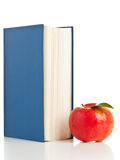 Book with apple Stock Photos