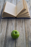 Book and apple Stock Images