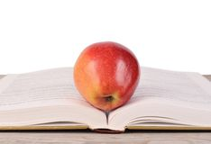 Book with apple isolated on white Royalty Free Stock Photography