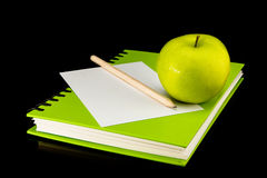 Book,apple,paper and pencil Stock Images