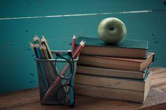 Book with apple and pencil box Stock Images