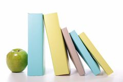 Book and apple Stock Photography