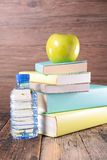 Book,apple and water Royalty Free Stock Images