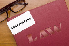 Book arbitration acts with business card. Legal Code for arbitration. Book arbitration acts with business card Stock Photo