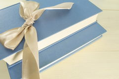 Book as a present. Two books decorated with a ribbon Royalty Free Stock Images