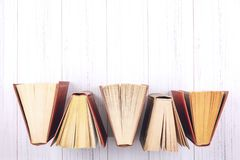 Book background. Top view of open hardback books on wooden table. Education, literature, knowledge, Back to school. Copy space royalty free stock photos
