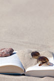 Book are on the beach Royalty Free Stock Photos