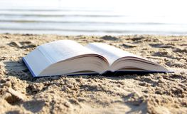 Book on the beach Stock Images