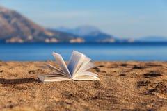 Book on a beach Royalty Free Stock Photos