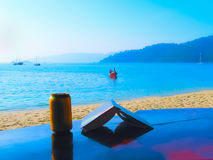 The book, bear, small boat at the Andaman Sea Stock Photo