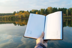 Book. Beautiful landscape. Black Book. Beautiful landscape  with mirror reflections Royalty Free Stock Image