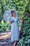 With a book Beautiful laughing bride with decorative umbrella Stock Photos