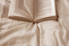Book on a Bed Royalty Free Stock Images