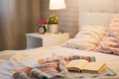 Book on the bed. In the bedroom interior Royalty Free Stock Photo