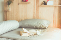 Book and bed Stock Photography