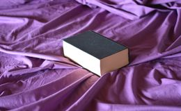A book and a bed. Pages, books, diaries, all on paper sheets royalty free stock photo