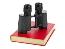 Book and binoculars Stock Images