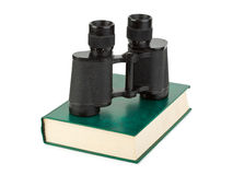 Book and binoculars Stock Photography