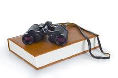 Book and binoculars Royalty Free Stock Photos