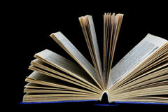 Book on a black background - close-up Royalty Free Stock Photos