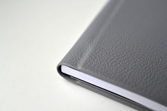 Book with black leather cover Royalty Free Stock Image