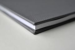 Book with black leather cover Stock Photography