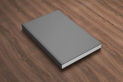 Book with blank cover on wooden background Royalty Free Stock Photo