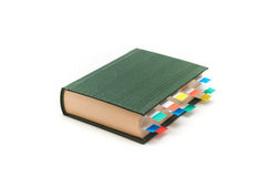 Book with bookmarks. Book with colorful bookmarks (paper sticks Stock Photo