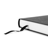 Book with bookmarks made of black cloth Royalty Free Stock Photos