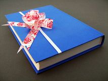 Book with bow royalty free stock photo