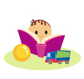 Book and boy. Cute little boy with book and toys Stock Images