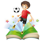 A book with a boy playing football Royalty Free Stock Photos