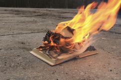 Book with burning pages on a concrete surface. Book with burning pages on concrete surface royalty free stock photos