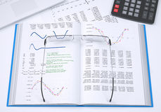 The book, calculator and paper charts Stock Photo